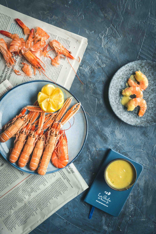 Une mayonnaise à la mangue pour accompagner des fruits de mer. Une recette sucrée/salée exotique qui en séduira plus d'un.